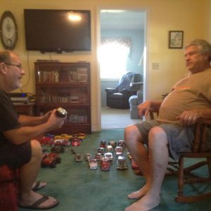 Pastor Jim Irwin (right) in his home.